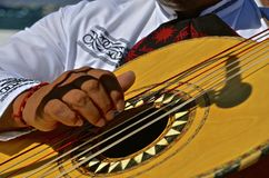 Fingers strumming a guitar Royalty Free Stock Photography