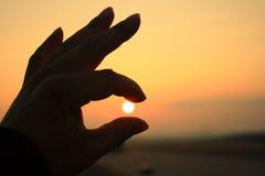 Fingers on sunset Stock Photo