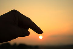 Fingers on sunset Royalty Free Stock Image
