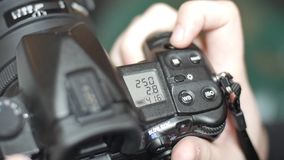 Fingers switched camera settings SLR camera. Switching and setting of switches