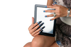 Fingers on tablet Stock Images