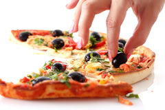 Fingers takes olive Stock Photography