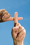 Fingers That Form A Cross Royalty Free Stock Image