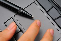 Fingers on touch pad Royalty Free Stock Images
