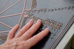 Fingers touching braille tourist map Royalty Free Stock Photography