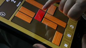 Fingers touching icons on the tablet game stock video