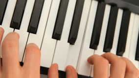 Fingers touching piano keys stock video footage