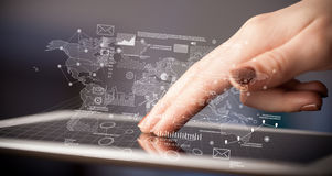 Fingers touching tablet with charts Royalty Free Stock Images