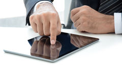 Fingers touching tablet computer Royalty Free Stock Image