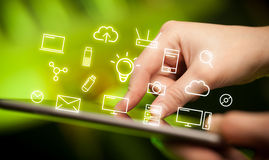 Fingers touching tablet with icons Stock Photos
