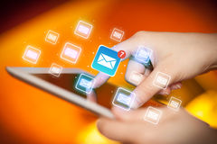 Fingers touching tablet with mail. Female hands touching tablet with e-mail icons Stock Photo