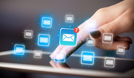 Fingers touching tablet with mail. Female hands touching tablet with e-mail icons Stock Image
