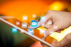 Fingers touching tablet with mail. Female hands touching tablet with e-mail icons Royalty Free Stock Photo