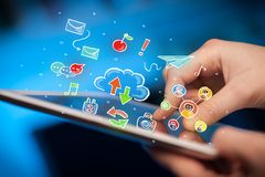 Fingers touching tablet with social icons Royalty Free Stock Photo