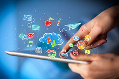 Fingers touching tablet with social icons Royalty Free Stock Images