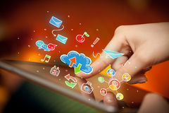 Fingers touching tablet with social icons. Female hands touching tablet with colorful social media icons Royalty Free Stock Photography