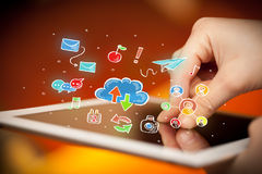 Fingers touching tablet with social icons Royalty Free Stock Image
