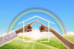 Fingers touching together made the form of house. Family concept Royalty Free Stock Photos