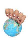 Fingers Travel the World. A series of finger steps on a globe imply world travel on white royalty free stock photo