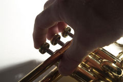 Fingers on Trumpet Valves. Closeup of fingers playing valves on a trumpet Royalty Free Stock Photo