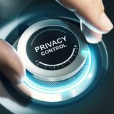 Privacy Control Settings. Fingers turning a black knob and setting privacy control to the maximum. Composite image between a hand photography and a 3D background Royalty Free Stock Photos