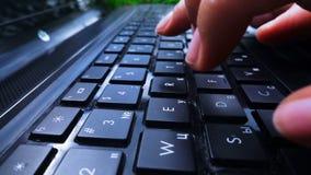 Fingers types on laptop keyboard stock video footage