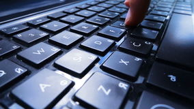 Fingers types on laptop keyboard stock footage