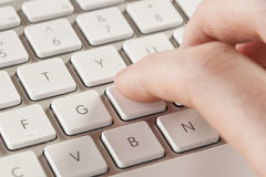 Fingers Typing on a Computer Keyboard Stock Image