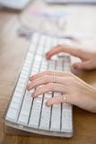 Fingers typing on a computer keyboard Royalty Free Stock Image