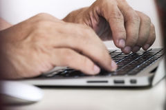 Fingers typing on keyboard Stock Photos