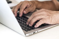 Fingers typing on keyboard Royalty Free Stock Photo