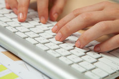 Fingers Typing on keyboard in close-up Royalty Free Stock Photography