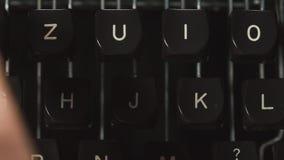 Fingers typing on typewriter, close-up. Close up fingers typing on typewriter stock footage