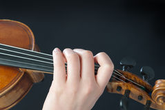 Fingers on the violin Stock Photography