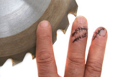 FINGERS VS TABLE SAW Table saw accident stock photography