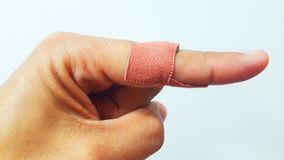 Fingers - Fingers - Wound. Finger wound - Thousands with adhesive plaster - Accident on finger Stock Photo