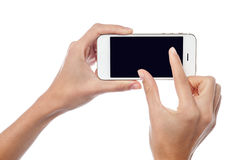 Fingers zooming in on cell phone Royalty Free Stock Photos