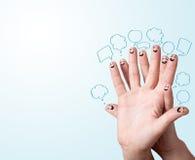 Fingersmiley mit Spracheblasen. Stockfotografie
