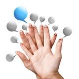 Fingersmileys med färgrika anförandebubblor Arkivbild