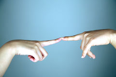 Fingertips touching. Pair of fingertips touching each other royalty free stock photo