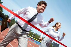 At finish. Photo of successful businessman crossing finish line during race Royalty Free Stock Photography