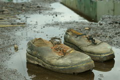 Finish. My old mud Dr.Martens shoes Royalty Free Stock Photos