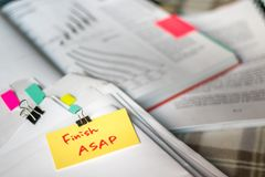 Finish ASAP; Stack of Documents with Large Amount of Analytic Ma. Terial Royalty Free Stock Photography