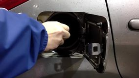 Finish filling up car gas tank and closing fuel cap stock video