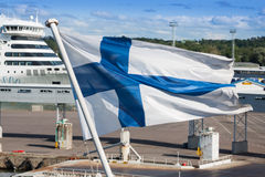 Finish Flag towards Blue sky, Finland, Stock Photo