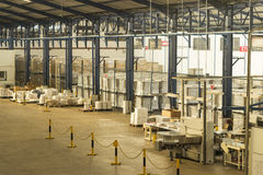 Finish good warehouse and cutting machine Stock Images