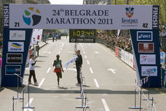 Finish of half marathon for man. BELGRADE - APRIL 17:24th Belgrade Marathon.Finish of half marathon for man Winner is Bikila Adugna Takele(ETH) with time:1 hour royalty free stock images