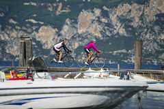 Finish at lake with bike - garda trentino italy. When a dream have success Stock Images