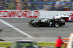 Finish Line. Motion blur of stock car race cars crossing the finish line stock photography