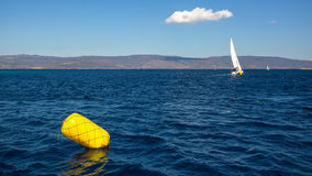 Finish line buoy at sailing sea yacht race regattas. Luxery vacations, adventure, travel Stock Photo